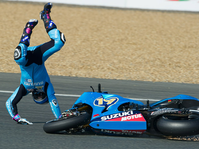 Alvaro Bautista of Spain crashes his Rizla Suzuki during the second free practice session of the MotoGP French Grand Prix on May 22 in Le Mans, France.