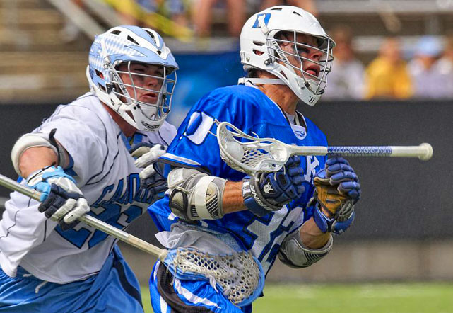 Duke midfielder Sam Payton has the ball and his stick knocked out of his hands by North Carolina midfielder Michael Burns during their NCAA quarterfinal match at Princeton Stadium May 22 in New Jersey. Duke advanced with a 17-9 victory.