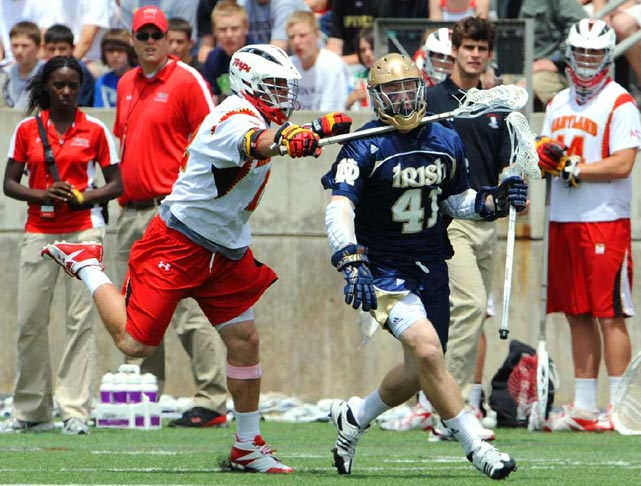 Notre Dame midfielder Quinn Cully gets hit in the neck with the stick of Maryland midfielder Adam Sear during their NCAA quarterfinal game on May 22 at Princeton Stadium. No. 14 Notre Dame upset No. 3 Maryland 7-5.
