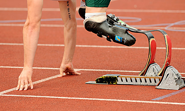 Oscar Pistorious of South Africa prepares at his starting blocks before winning the 400m during the BT Paralympic World Cup May 25 at Sport City in Manchester, England.