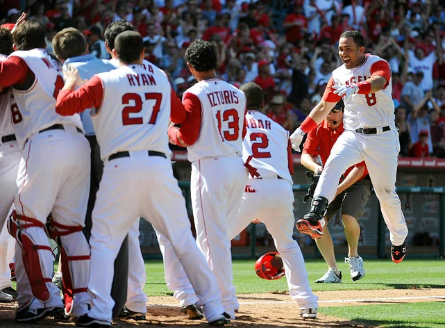 Kendry Morales of the Los Angeles Angels celebrates his walkoff grand slam in a 5-1 win over the Seattle Mariners May 29 in Anaheim.  Unfortunately, Morales broke his leg during the celebration at home plate.
