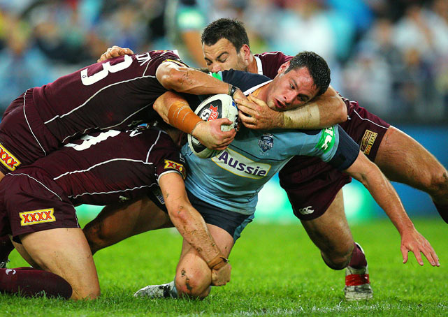 Brett White of the Blues is tackled during Game 1 of the ARL State of Origin series between the New South Wales Blues and the Queensland Maroons at ANZ Stadium May 26 in Sydney. Queensland defeated New South Wales 28-24.