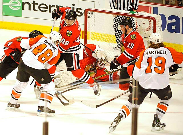 Chicago Blackhawks goalie Antti Niemi is sprawled in the crease as he watches the puck go in on a goal by Philadelphia Flyers Danny Briere during the first period in Game 1 of the Stanely Cup Final May 29 at the United Center in Chicago. The Blackhawks prevailed 6-5.