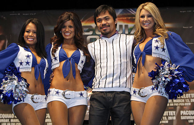 Pacquiao with Cowboys cheerleaders during a news conference to promote his fight against Joshua Clottey in Arlington, Texas.