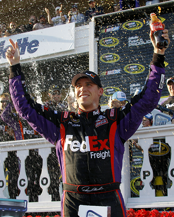 "Hamlin won again at Pocono, pulling away from teammate Kyle Busch following a late restart Sunday in the 500-mile race at the massive 2.5-mile oval. The victory was his fourth of the season and fourth in nine career starts at the ""tricky triangle."""