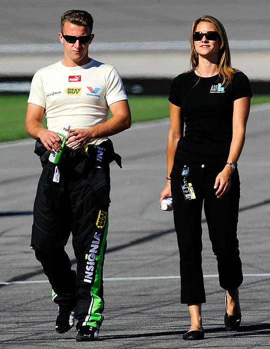 A.J. Allmendinger and his wife Lynne walk on pit road prior to the start of the Price Chopper 400 in Kansas City.