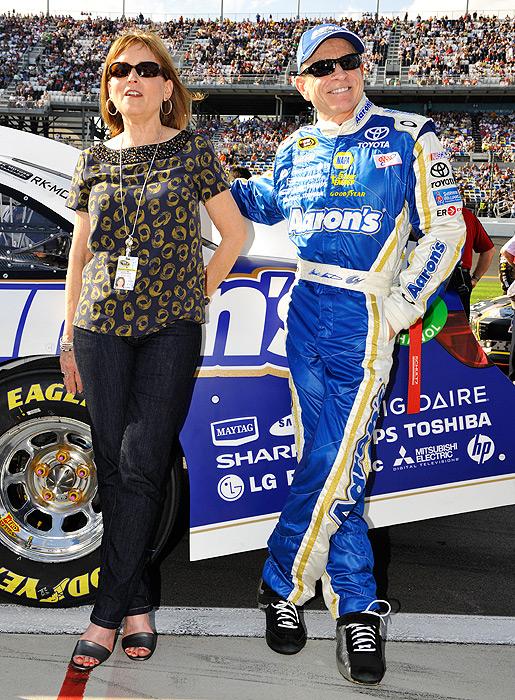 Mark Martin strikes the same pose as his wife Arlene at Daytona International Speedway.