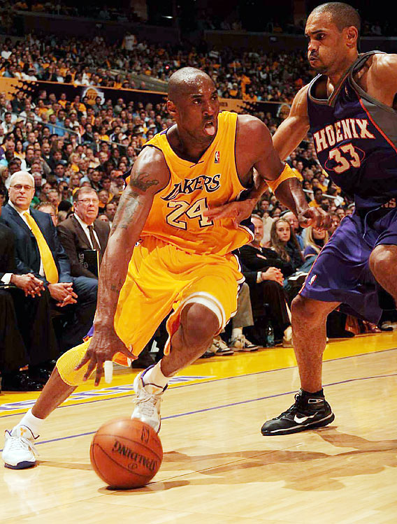 "Questions surrounding Kobe Bryant's health and the Lakers' bench were put to rest as the defending champs pummeled the Suns 128-107 Monday night. Bryant dropped 40 points amid chants of ""M-V-P!"" inside the Staples Center, and the Lakers jumped to a 1-0 lead in the Western Conference finals. Here are some of SI's best shots from the game."