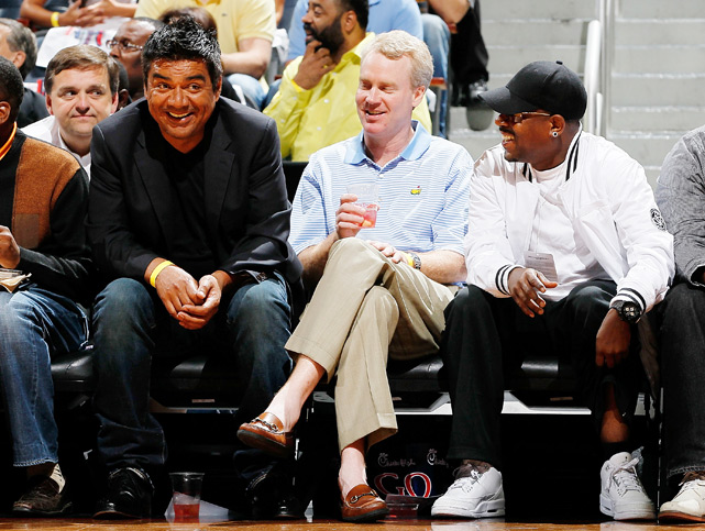 Comedians George Lopez (far left) and Martin Lawrence (right) share a laugh during Game 1 of the Hawks-Bucks series.