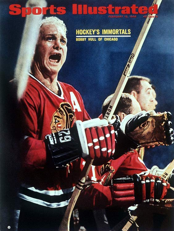 "The Golden Jet's speed, ferocious 120-mph slapshot, and brute strength were an awesome record-breaking combination. Hull, who skated on Chicago's famed ""Million Dollar Line"" with Bill Hay and Murray Balfour, is credited with developing the curved stick blade and bringing the spark back to Chicago, as the Blackhawks had missed the playoffs in 11 of the 12 seasons before his arrival in 1957. With him, the `Hawks won the Stanley Cup in 1961 and reached the final in 1962, '65 and '71. During his 15 seasons in Chicago, the left winger scored 30 or more goals in a season 13 times, potting 50 or more five times. He was enshrined in the Hockey Hall of Fame in 1983."