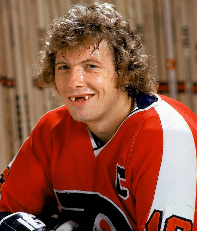 Due to his diabetes, many teams were skeptical about drafting Bobby Clarke.  He was still available in the second round of the 1969 draft when the Flyers took him 17th overall. So began his 15 seasons with the club.  He proved to be a fierce competitor with an unparalleled work ethic and was named team captain at age 23.  His rough and, at times, controversial style of play gave him the title of one of hockey's most hated villains on the sport's most hated team, but he was beloved in Philly where he led the Broad Street Bullies to two Stanley Cups.  Upon retirement, he had amassed 358 career goals and 1,453 penalty minutes. He was inducted into the Hockey Hall of Fame in 1987 and served as the Flyers' GM from 1994 to 2006.