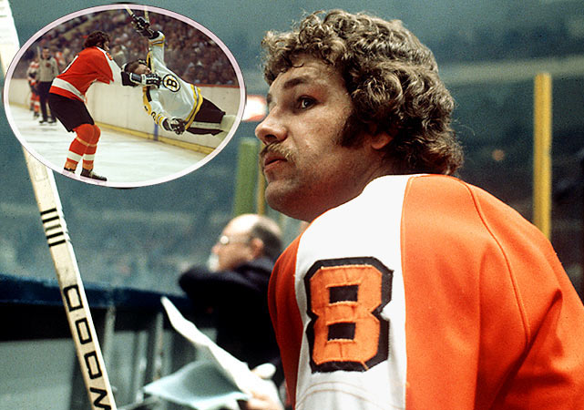"Although he spent only five years with the Flyers, Dave Schultz sure left an impression.  The most notorious member of the Broad Street Bullies, the enforcer was never one to shy away from dropping the gloves with brutes like Chicago's Keith Magnuson, and he earned the appropriate nickname ""The Hammer.""  Schultz led the NHL in penalty minutes from 1972-75, recording 259, 348 and 472, respectively.  When he retired in 1980, he left with 2,294 regular season penalty minutes and 412 playoff minutes in the sin bin. But the left winger contributed in other ways as well.  During the '73-'74 season, he scored 20 goals during the Flyers' first run to the Cup."
