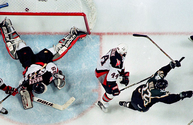 "Added to the NHL for 1970-71, the Sabres have become accomplished heartbreakers, tantalizing their devoted fans with scrappy and often talented teams. They lost the 1975 Stanley Cup Final to defending champion Philadelphia in six games, and the '99 final to Dallas, thanks to Brett Hull's controversial ""foot in the crease"" goal in Game 6 (pictured). The Sabres have also fallen one round shy in 1980, '98, 2006 and 2007."