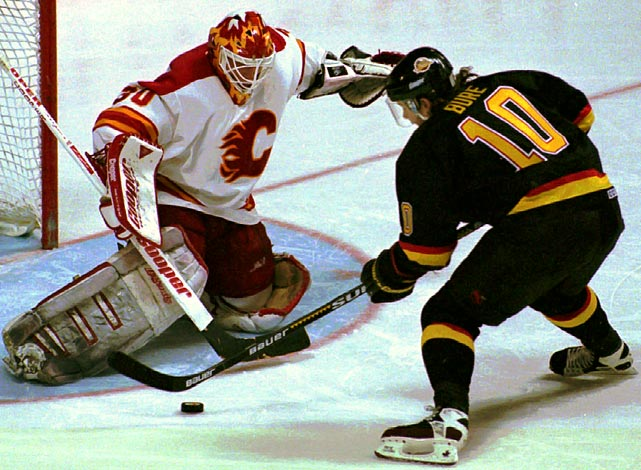 "The second-seeded Flames held a three-games-to-one lead over the seventh-seeded Canucks in their first round series. Calgary goalie Mike Vernon seemed in charge after his 42-save outing in Game 4. But it all fell apart after Vancouver's Geoff Courtnall won Game 5 in OT. In Game 6, the Flames twice coughed up leads and lost in OT again, thanks in part to a too-many-men-on-the-ice penalty. Game 7 in Calgary ended up in double OT after the Flames surrendered a 3-2 third-period lead and Kirk McLean's ""save of the century"" on Robert Reichel in the first extra session set the stage for Pavel Bure's game-winner three minutes into the next frame."