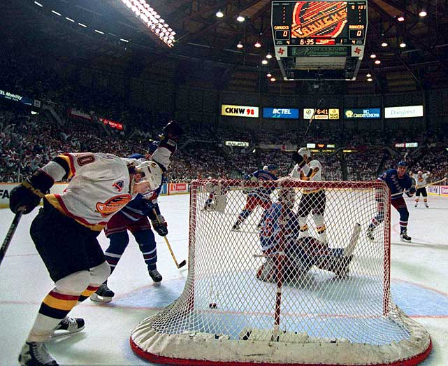 "In the first year of the new conference-seeded format, coach Pat Quinn's Canucks (41-40-3, 85 points) were the West's seventh seed. Their top scorer, Pavel ""the Russian Rocket"" Bure, had a reputation as a playoff fizzle, but he capped a three-games-to-one comeback with a double OT goal in a Game 7 first-round upset of rival Calgary. The waters parted as top-seed Detroit was taken out by No. 8 San Jose, and after a five-game takedown of Dallas with Bure on a rampage, the Canucks knocked out No. 3 Toronto to meet the NY Rangers in an epic seven-game Cup final in which they nearly overcame another three-games-to-one deficit."