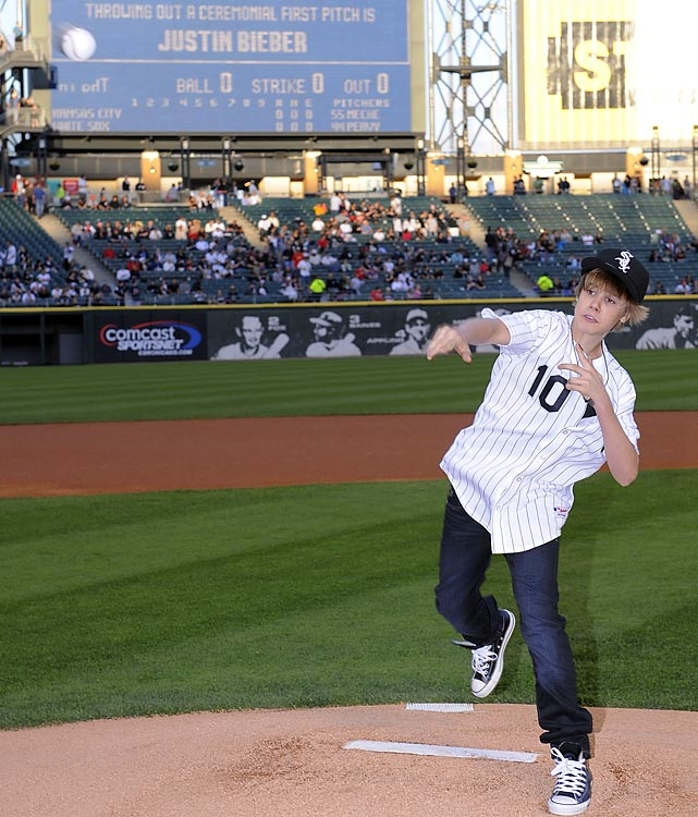 In town to tape an episode of Oprah, Justin Bieber threw out the first pitch at the May 3 Chicago White Sox game.  While the teen heartthrob didn't throw a strike, the ball did make it to the plate without bouncing.  Even luckier -- he even caught a foul ball that reached his suite.  Ever the gentleman, Bieber gave it to a fan.