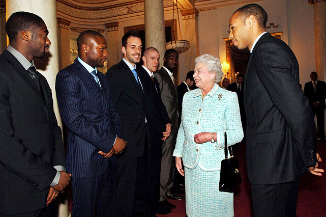 Queen Elizabeth II greets Henry and his Arsenal teammates at Buckingham Palace in London.