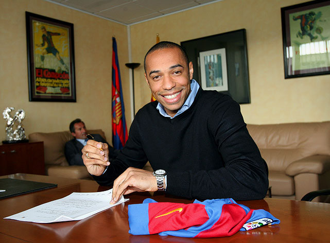 Henry is all smiles as he signs a four-year contract with FC Barcelona.