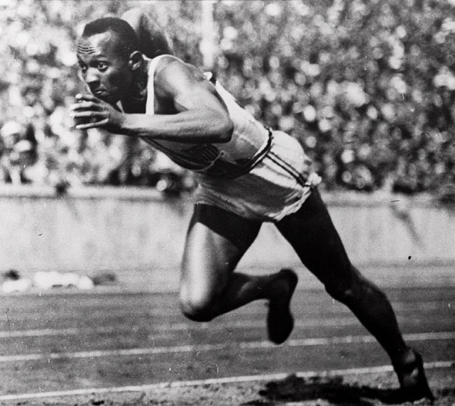 Jesse Owens ties the world record for the 100-yard dash with a time of 9.4 seconds.