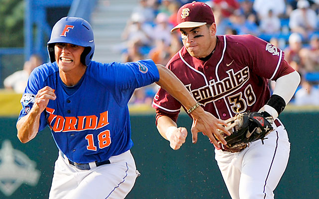 Florida's Tyler Thompson tries to escape Florida State's Stephen Cardullo in a run down. The Gators eventually succumbed to the Seminoles -- after a ninth-inning rally -- to become the first team sent packing from the College World Series.