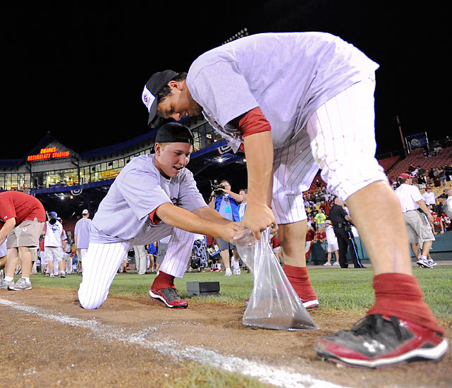 South Carolina players Michael Roth, right, and Patrick Sullivan, collect dirt after the final College World Series game at Rosenblatt Stadium. The 'Blatt had hosted the College World Series since 1950.