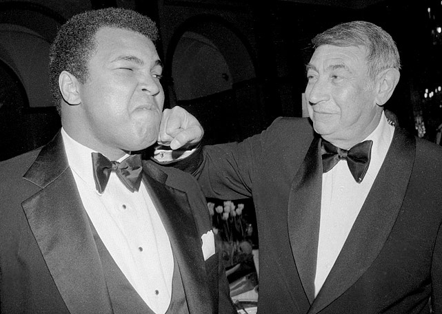 Longtime friend Cosell lays one on Ali's chin during a dinner marking the 20th anniversary of ABC's  Wide World of Sports  in 1981. Cosell passed away at age 75 in 1995.