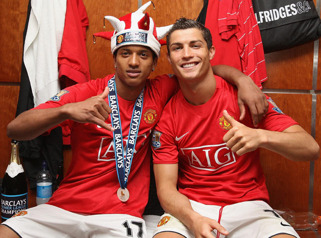 Ronaldo and Nani celebrate in the dressing room after the Barclays Premier League match between Manchester United and Arsenal at Old Trafford in Manchester.
