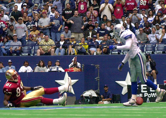 T.O. celebrated two touchdowns by running over and standing in the star in the middle of Texas Stadium. A chorus of boos from Cowboys fans wasn't the only thing T.O. was greeted with after his second trip as Cowboys safety George Teague drilled into T.O., knocking him clear out of the beloved star and earning the admiration of fans in the stands that day.