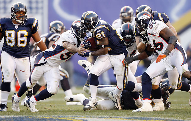 "LaDainian Tomlinson set the NFL record for touchdowns in a season in 2006 when he scored three times against the Broncos at Qualcomm Stadium. Late in the fourth quarter of the Chargers' AFC West-clinching 48-20 win over Denver, LT scored touchdowns No. 28 and 29. After Tomlinson eclipsed Seattle's Shaun Alexander, who scored 28 touchdowns the previous season, he was Mobbed by teammates and showered with chants of ""LT! LT!"" from the home crowd."