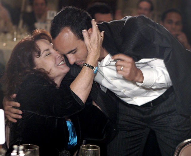 Donovan receives a kiss from his mother, Donna Kenney-Cash, after winning the Honda Player of the Year Award.