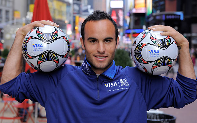 Donovan poses for photos at the FIFA World Cup final draw viewing event at the ESPN Zone in Times Square