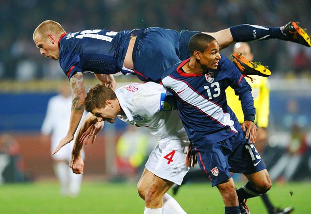 England's midfielder Steven Gerrard vies with U.S. defender Jay DeMerit and midfielder Ricardo Clark during a 1-1 tie on June 12  in Rustenburg.