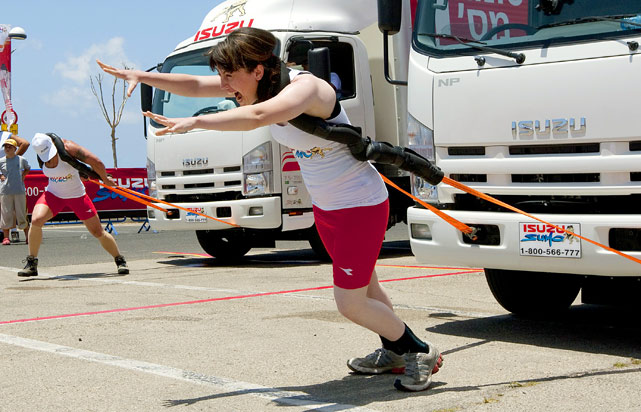 "Israeli female competitors perform the ""Truck Pull,"" a test of endurance held June 8 in Tel Aviv in which the challengers pull a 7.5 ton truck over a 30-meter course."