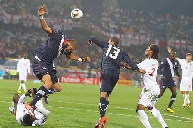 Oguchi Onyewu of the U.S. nearly steps on Emile Heskey of England while heading a ball in the opening World Cup game for both countries on June 12 at Royal Bafokeng stadium in Rustenburg. They tied 1-1.