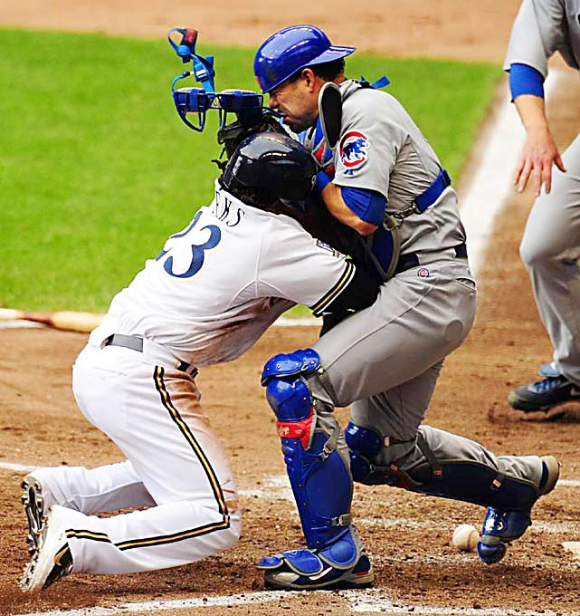 Rickie Weeks of the Milwaukee Brewers plows into Cubs catcher Geovany Soto to score in the fifth inning of their 5-4 home win over Chicago on June 10.