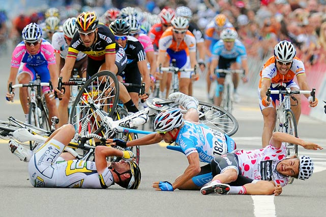 Mark Cavendish of England, Gerald Ciolek and Heinrich Haussler of Germany and Loyd Mondory of France crash near the finish line of the fourth stage Schawarzenburg  to Wettingen on June 15 during the Tour of Switzerland cycling race.