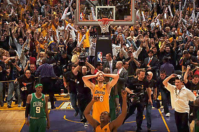 As guards held back cheering fans, Lakers forwards Pau Gasol and Ron Artest reveled in their 83-79 victory over Rajon Rondo and the Celtics in Game 7 of the NBA Finals at Staples Center in Los Angeles. The win gave the Lakers their 16th title, one short of Boston's record.