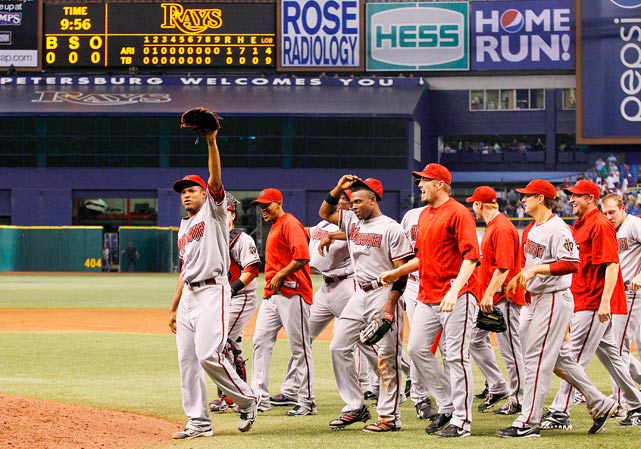 The Diamondbacks' Edwin Jackson (left) walks off the field after throwing a 149-pitch no-hitter against the Rays at Tropicana Field on June 25.