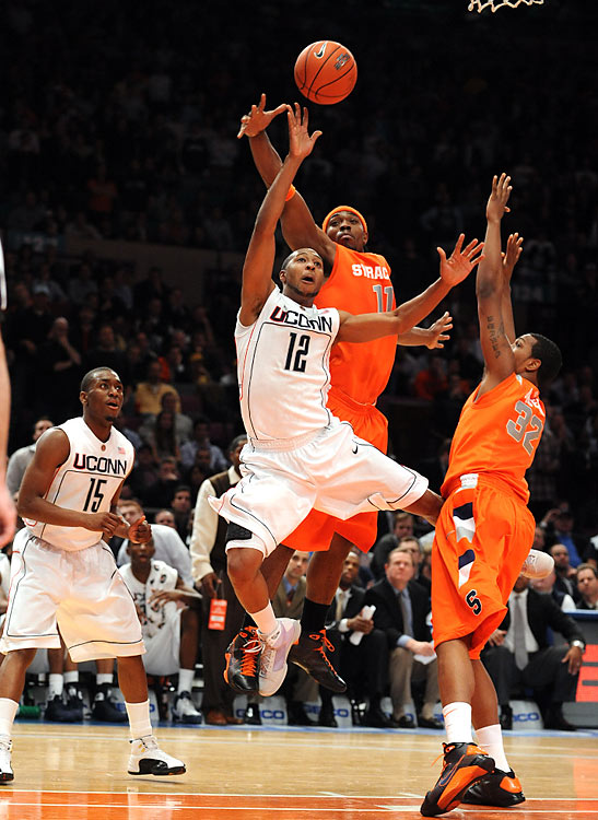 The longest NCAA game of the shot clock era lasted three hours 46 minutes in New York's Madison Square Garden, with Syracuse winning 127-117 over UConn. Six players registered double-doubles in the Big East Tournament quarterfinal match, and eight fouled out before the proceedings came to a close at 1:22 a.m.  Playing without a shot clock, Cincinnati and Bradley slogged through an NCAA Division 1 record 7-OT game on Dec. 21, 1981, before Cincinnati won 75-73.