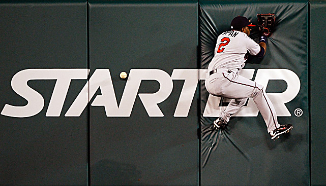 The Twins' Denard Span crashes against the center field wall as he chases a double hit by Hideki Matsui during their game at Anaheim on April 7.