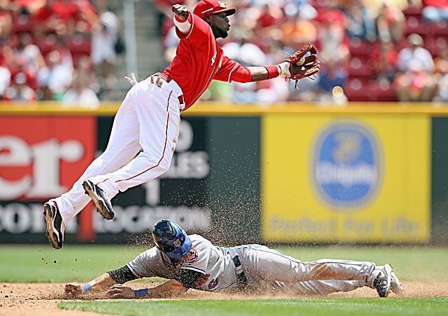 Angel Pagan of the New York Mets slides safely into second under Brandon Phillips of the Cincinnati Reds in a 5-4 loss by the visitors at Great American Ballpark on May 5.