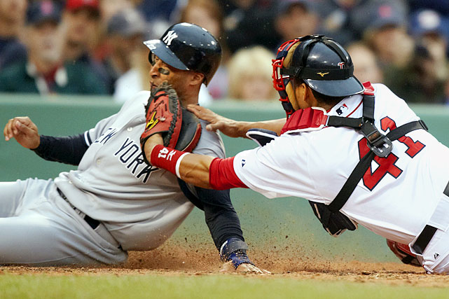 Red Sox catcher Victor Martinez tags out left fielder Randy Winn of the Yankees, who tried to score on a single by Francisco Cervelli in the fourth inning of their May 8 game at Fenway Park in Boston. The Yankees defeated the Red Sox 14-3.