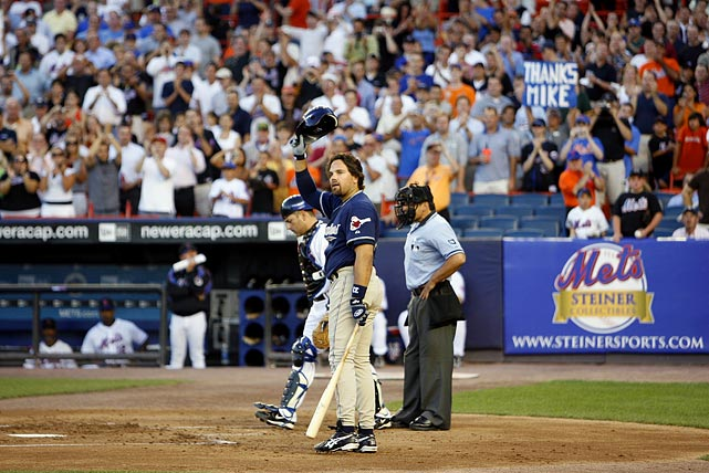 """The cheers flowed throughout the night for one of the Mets' all-time greatest catchers when he returned with the Padres. In his first at-bat, Piazza waved his batting helmet in salute of the cheering fans. """"That's how you treat heroes,"""" Mets manager Willie Randolph said of the crowd."""