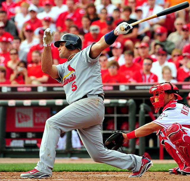 Who'll hit the most home runs this year? Which pitcher will have the most strikeouts? Those questions and others will be posed by SI.com over the next two months in a series of poll galleries with a ballot on the last frame. This week's question: Who'll win the NL MVP award?    Pujols picked up his third NL MVP award last season, and so far this year has followed up with more stellar play. Opposing pitchers fear Phat Albert -- he leads the NL in walks and ranks in the top five in the NL in home runs (14) and RBI (44).