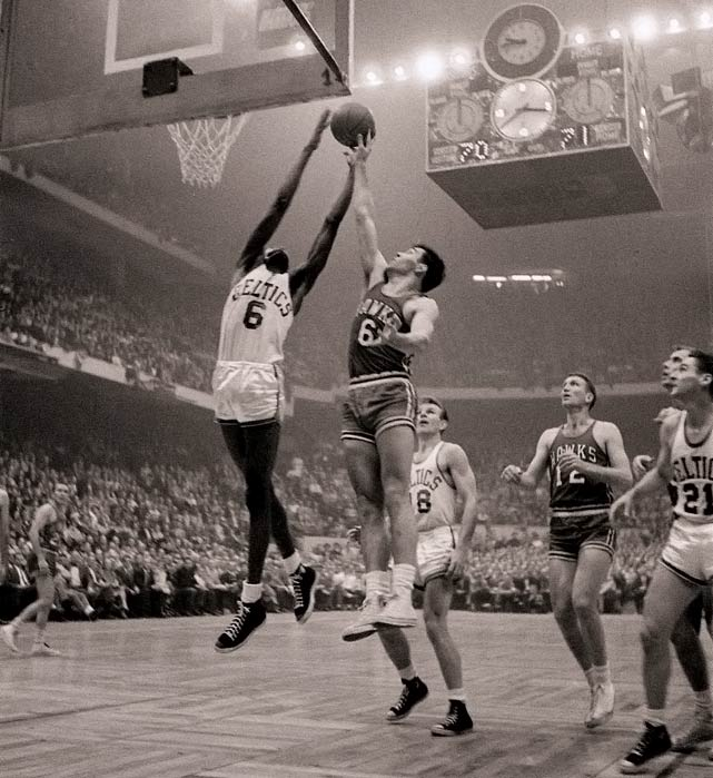 A rookie center named Bill Russell finished with 19 points and 32 rebounds, and fellow rookie Tom Heinsohn had 37 points and 23 rebounds as the Celtics overcame a combined 5-for-40 shooting performance from Bob Cousy and Bill Sharman to prevail in double overtime in Boston. It was Boston's first NBA championship.