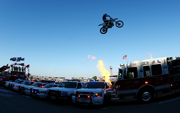 "Motorcycle daredevil Robbie Knievel jumps a line of police cars, ambulances and a fire truck spanning 200 feet in his ""Above the Law"" jump prior to the IZOD IndyCar Series Firestone 550k at Texas Motor Speedway June 5 in Fort Worth, Texas."