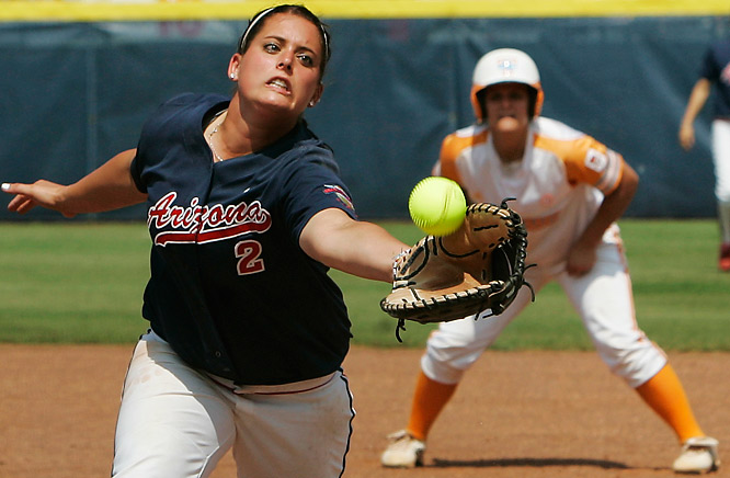 Arizona's Baillie Kirker reaches for a pop up by Tennessee's Nicole Kajitani in the first inning of an NCAA softball tournament game in Oklahoma City on  June 6. Arizona won 8-0.