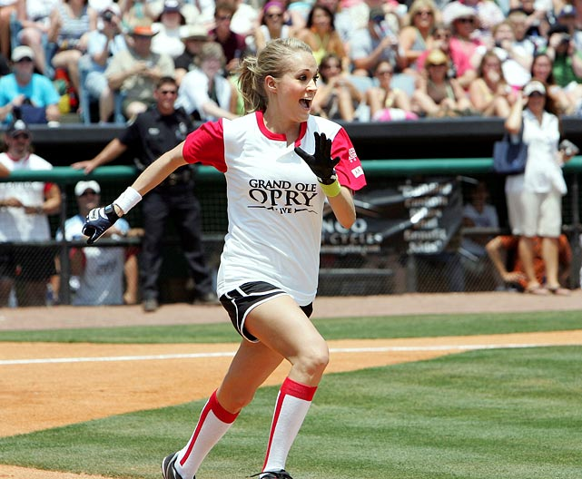 Carrie Underwood showed off her skills while playing in the City of Hope 20th Annual Celebrity Softball Challenge in Nashville. To date, the event has raised more than $2 million for City of Hope which is a research and treatment center for cancer and other serious diseases. Unfortunately, Underwood's team, Grand Ole Opry was defeated by After MidNite with Blair Garner.