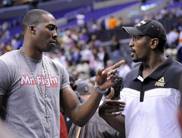 Artest hangs out with Dwight Howard during a WNBA game between the Los Angeles Sparks and the Seattle Storm.
