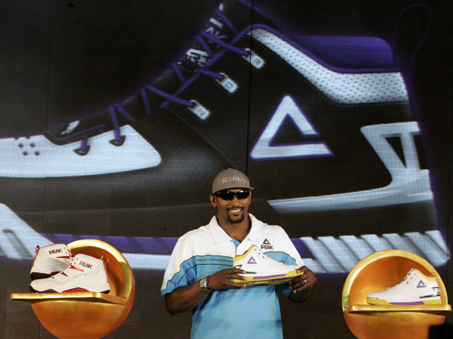 Artest attends a press conference in Beijing, where he shows off his line of Peak sneakers.